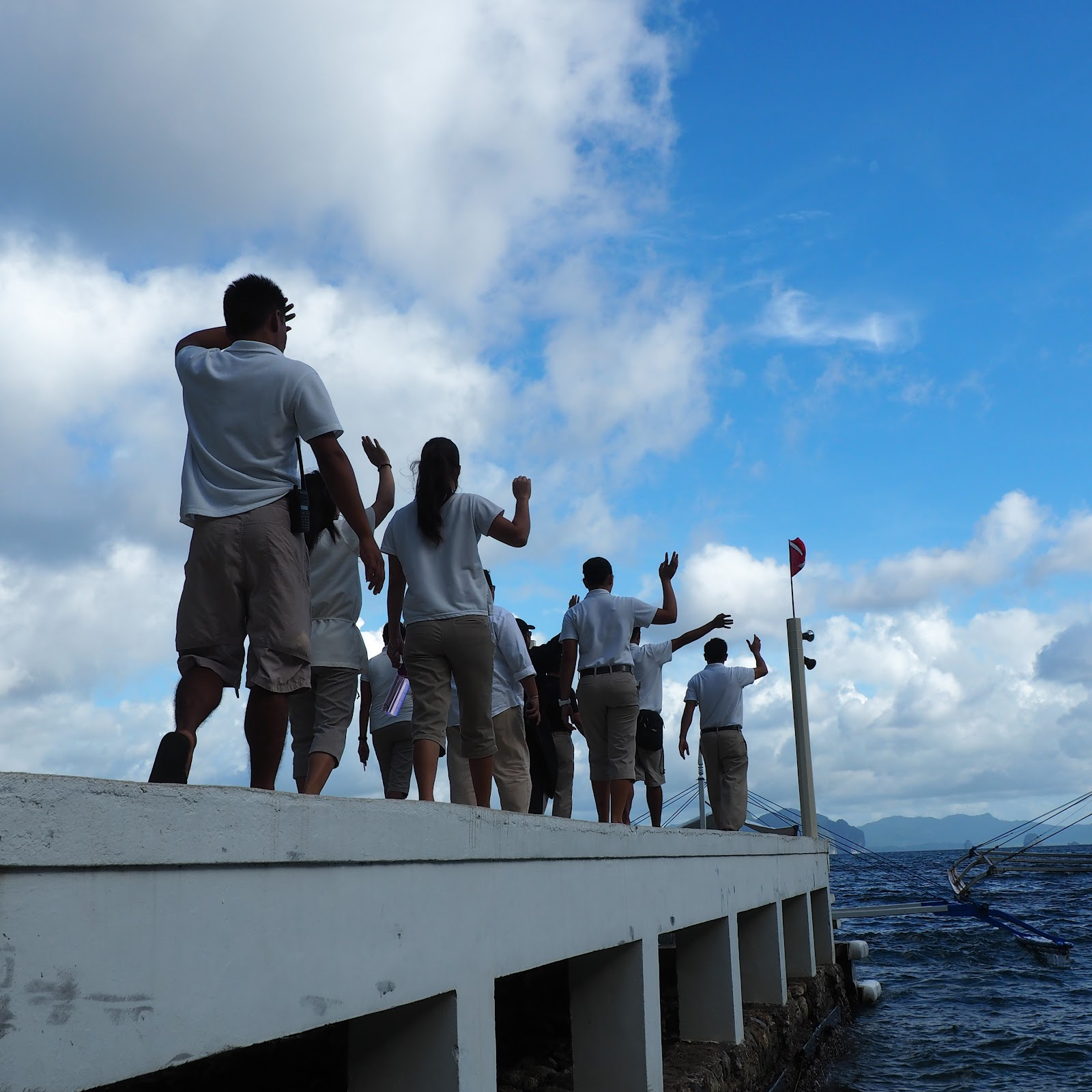 Miniloc Island Staff waving guests off
