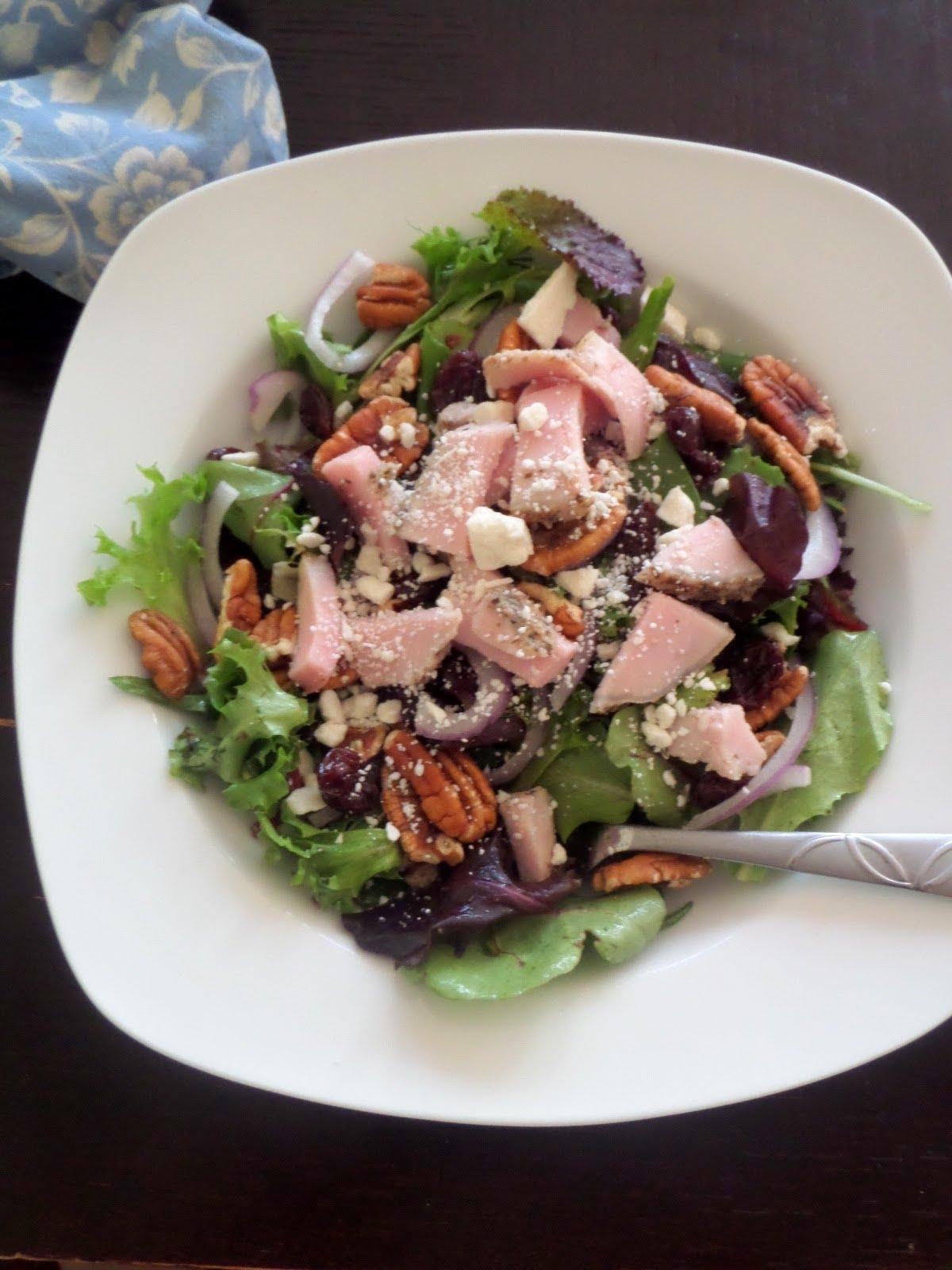 Pork Tenderloin Salad:  Tender Herb Roasted Pork Tenderloin on a green salad tossed in a lemon thyme dressing.