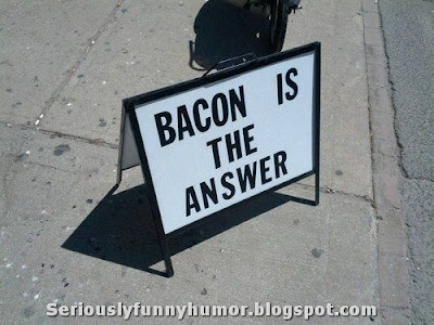 Bacon is the answer sidewalk sign