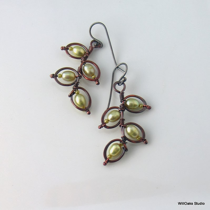 https://www.etsy.com/listing/179670551/green-pearl-earrings-metalwork-dangles?