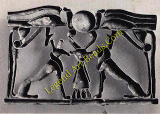 Egypt confronting the emblem of Bat below the protective eyes of the sun-god. XIIth Dynasty. Eton College, Windsor