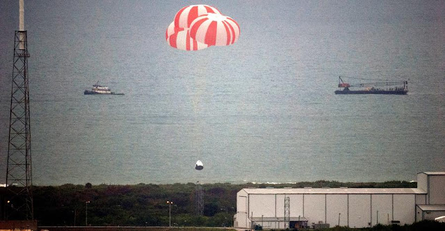 SpaceX's Crew Dragon spacecraft splashed down in the Atlantic Ocean under three main parachutes following a successful test on May 6, 2015 of the spacecraft's ability to save astronauts in the unlikely event of a life-threatening situation on the launch pad. Credits: NASA
