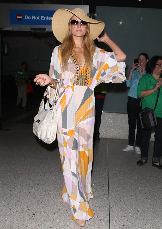 Paris Hilton at LAX airport in a stylish dress