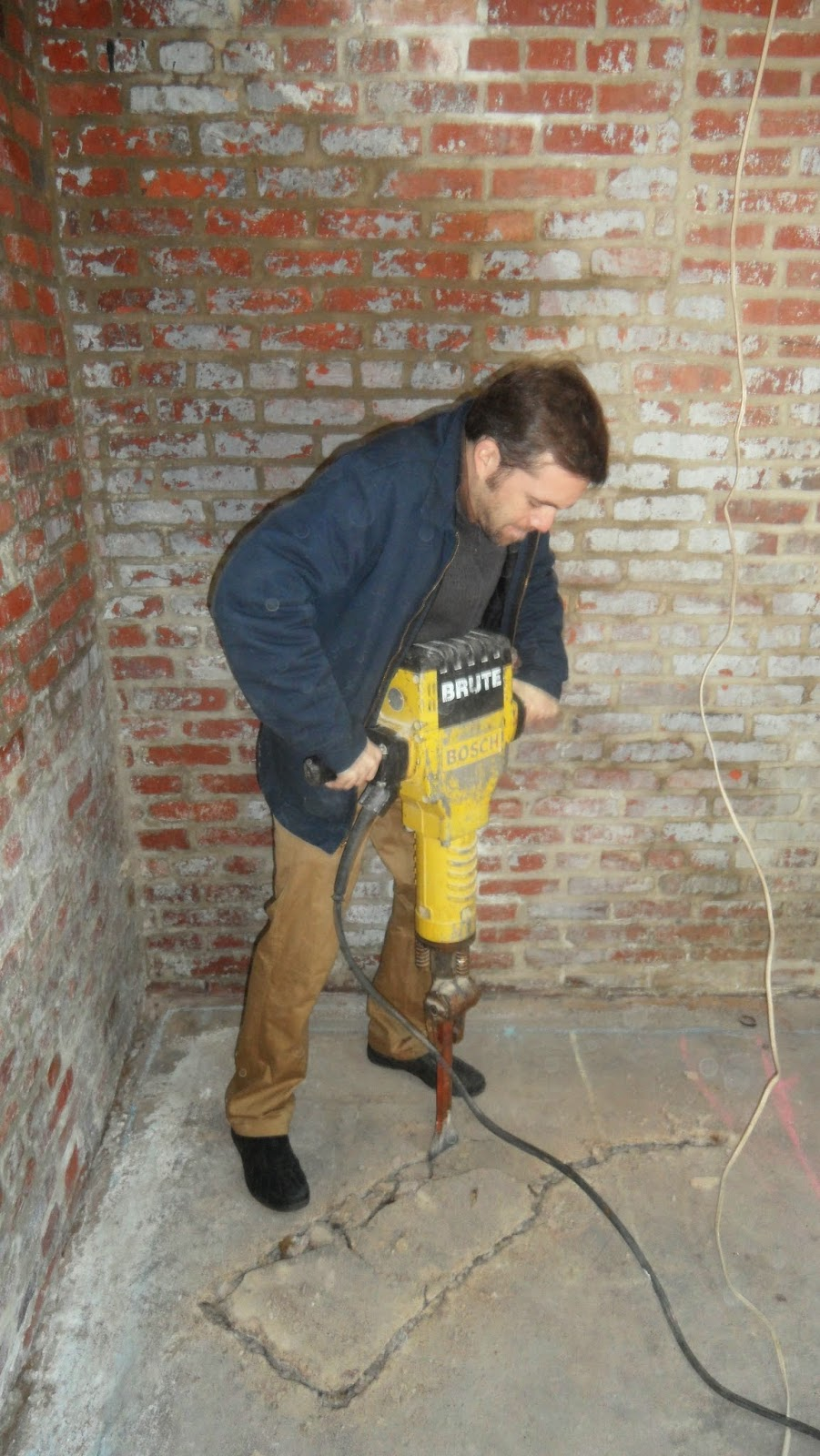 07-Removing-uneven-concrete-imgur-Storage-Unit-Renovation-in-Tiny-Architecture-www-designstack-co