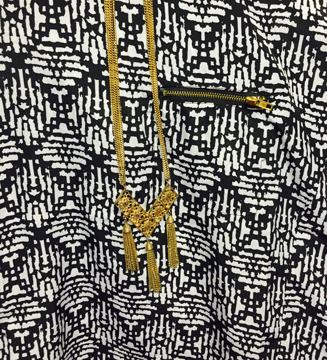 http://cannycanaryshop.com/collections/vintage-necklaces/products/70s-sarah-coventry-triple-tassel-necklace