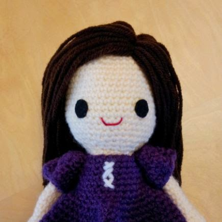 Crochet amigurumi Nami doll - yarn hair, face, head, and dress sleeves