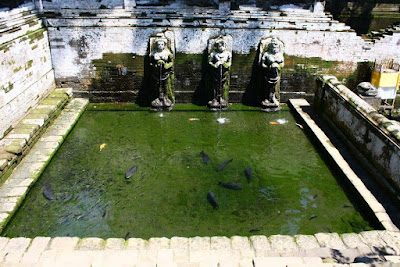 Holy water pond with three statues at Goa Gajah Gianyar Bali