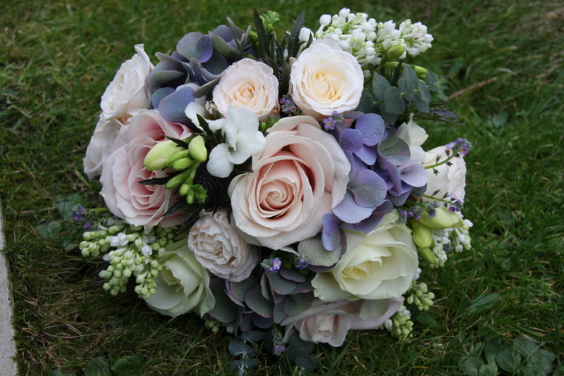 Blue wedding bouquet in lovely spring blooms including White Lila