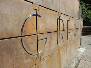 Grec Letters on Stone Entrance to Barcelona Theatre