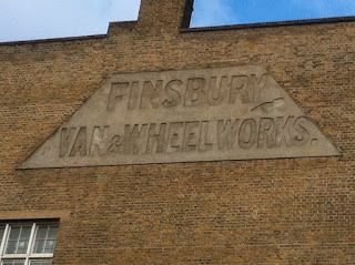 Ghost sign for Finsbury Van and Wheel Works, Old Street, London EC1