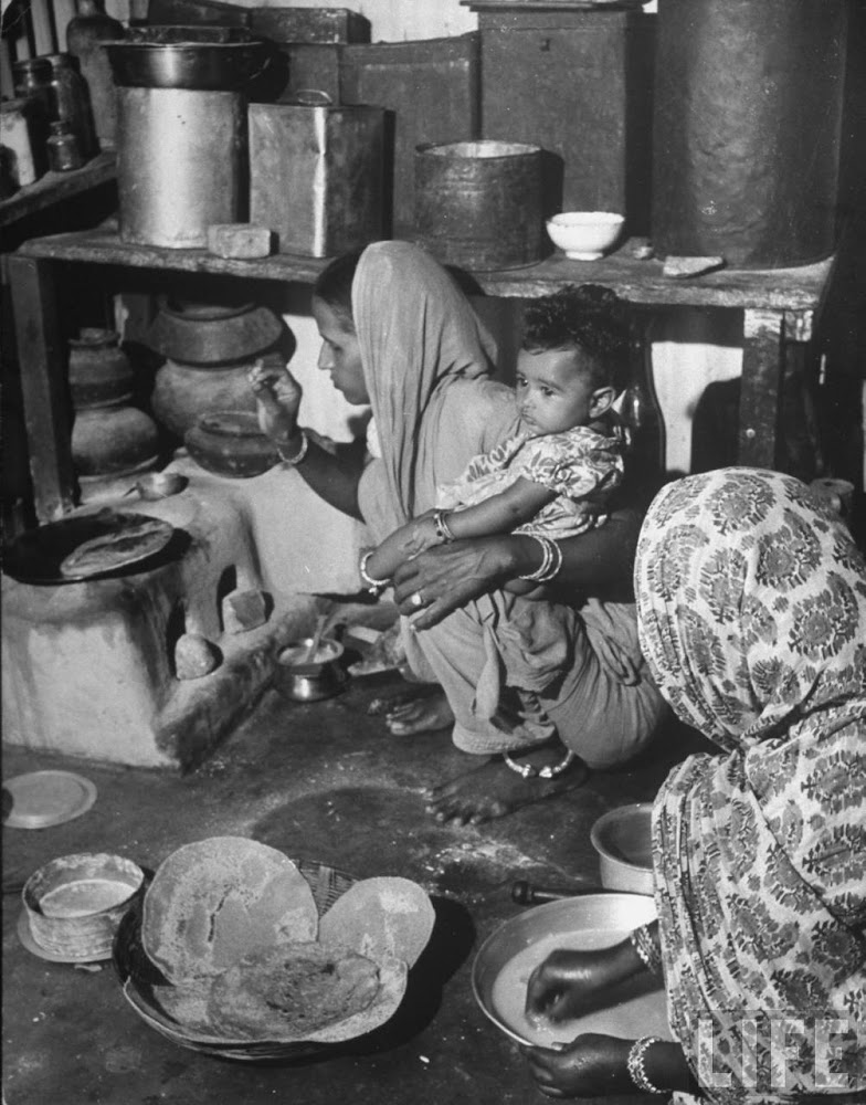 Indian women holding her child