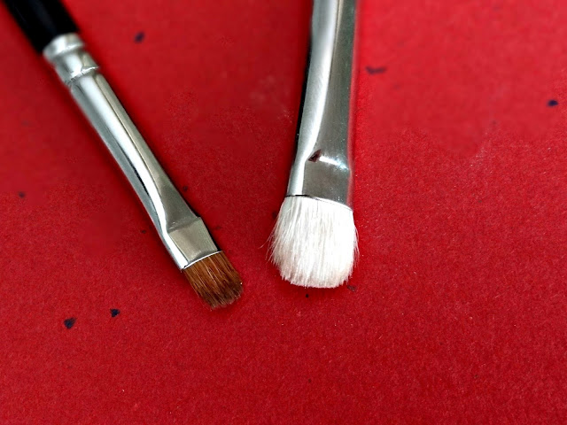 Hakuhodo K005 Eye Shadow Brush round and flat size comparison next to a MAC 239