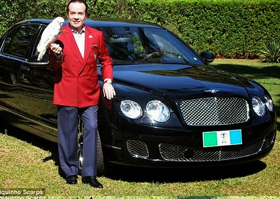 (Photos)Man buries his £310,000 Bentley so he can keep balling in his afterlife