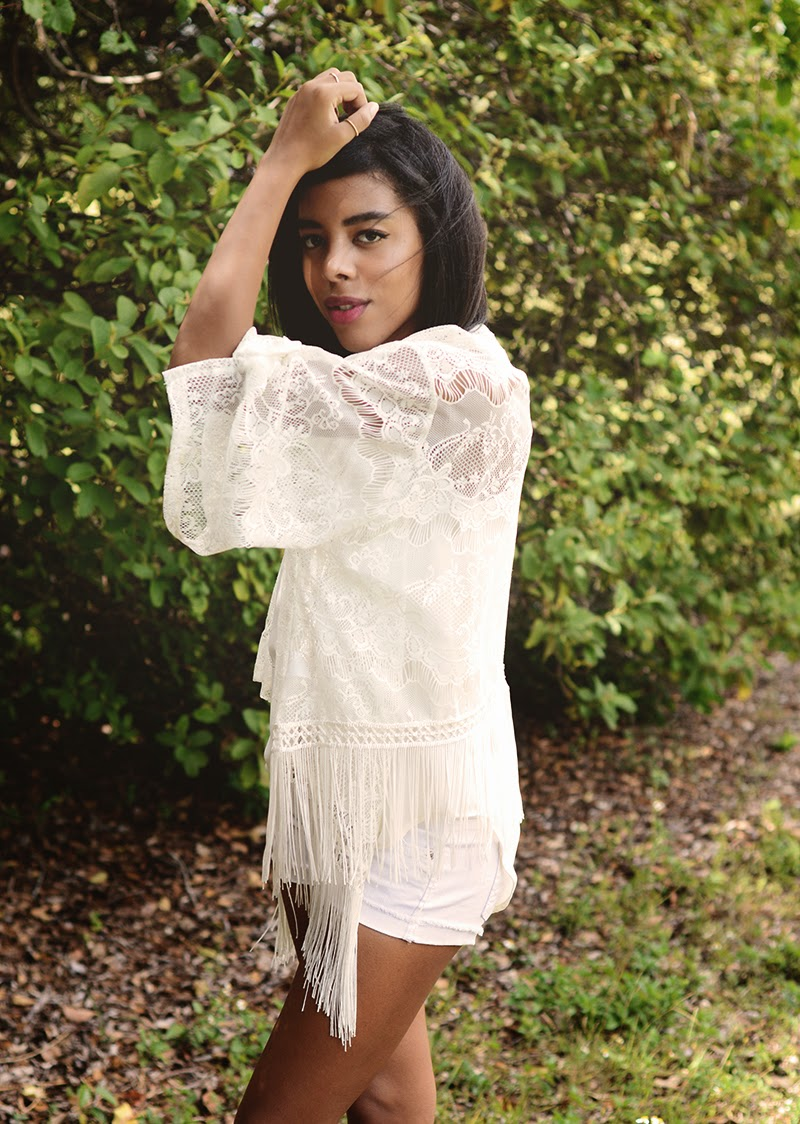 Indie and Outdoorsy Fashion Blogger Anais Alexandre in an all white outfit