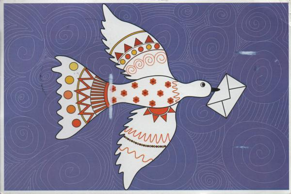 decorated white dove of peace with letter in its beak