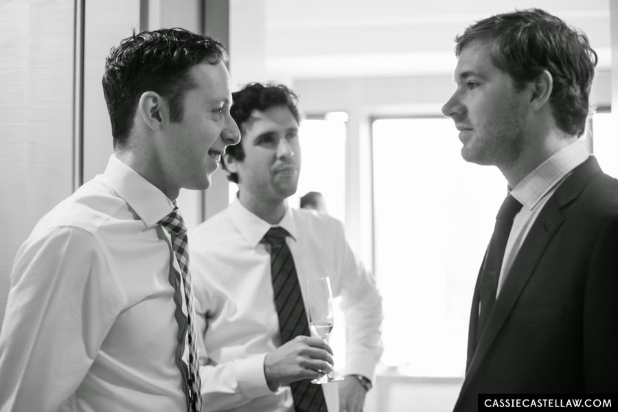 Candid of Groom and groomsmen. NYC Lifestyle wedding photography by Cassie Castellaw. www.cassiecastellaw.com