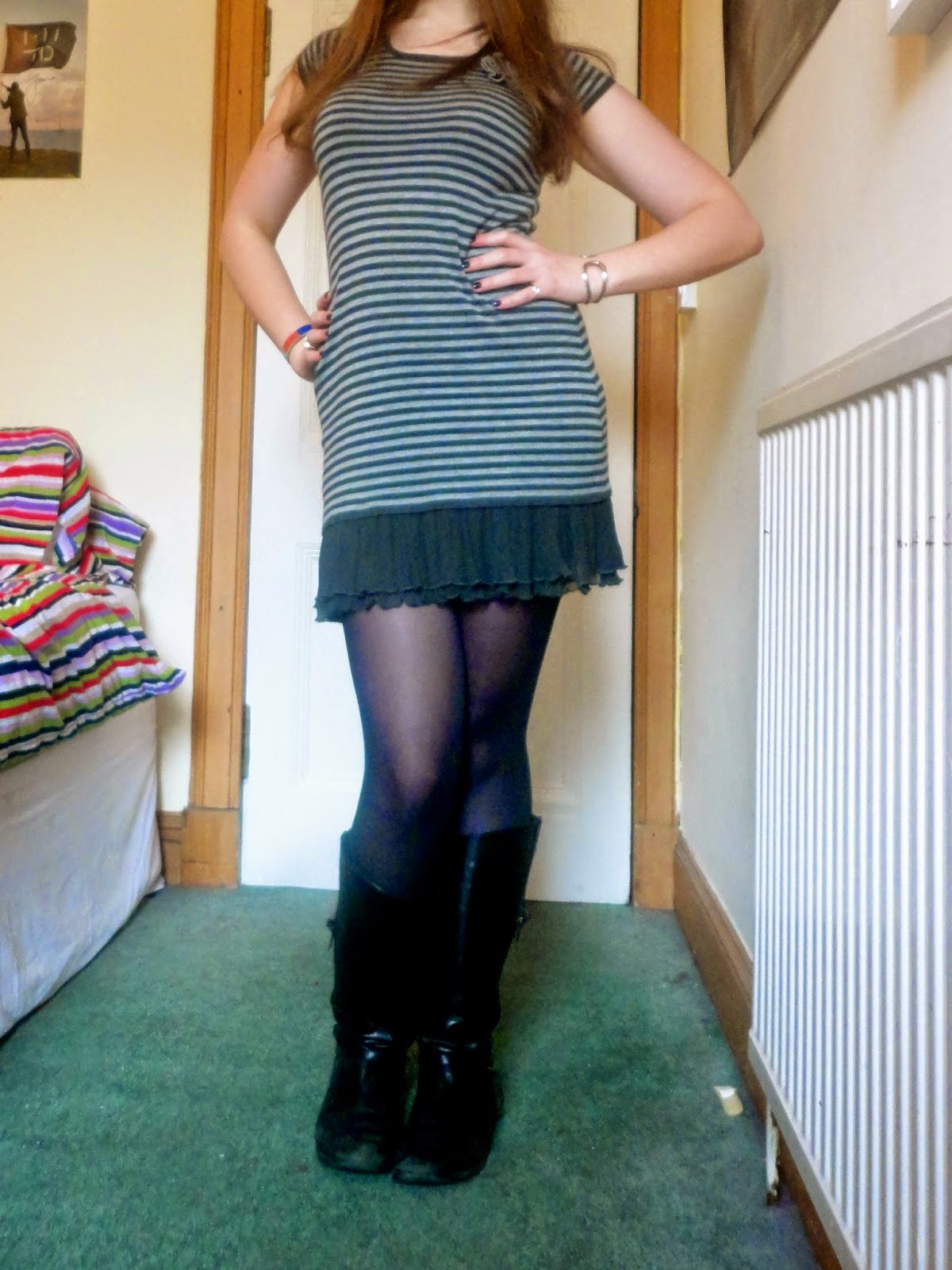 Outfit of grey striped dress with black tights and boots