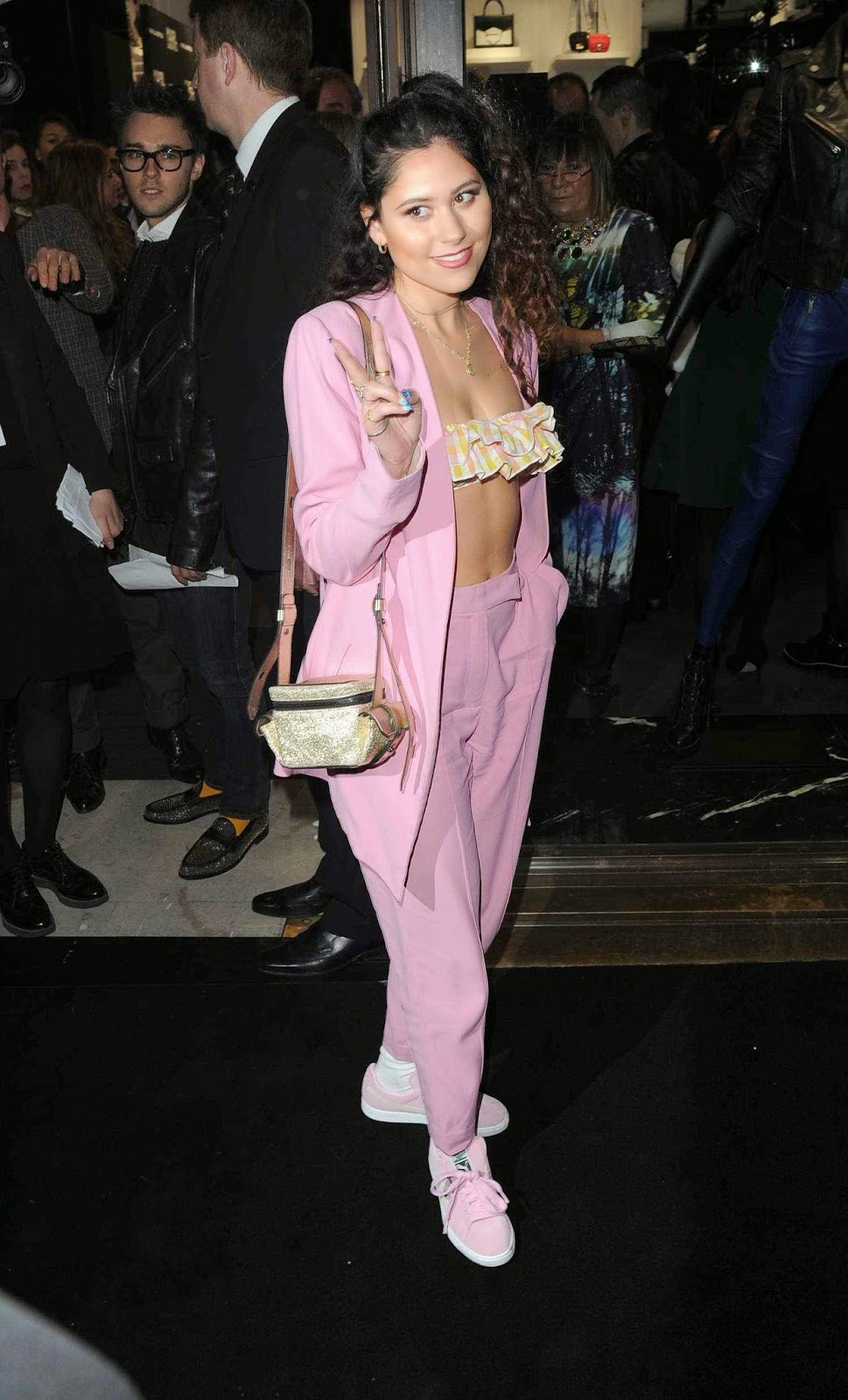 Eliza Doolittle wearing tube bikini top under the wide open pink outfit at Karl Lagerfeld's store opening in London