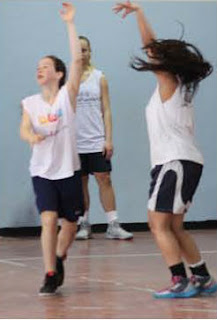 Jewish and Arab girls play basketball