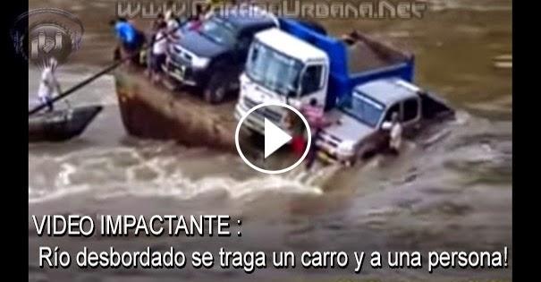 VIDE IMPACTANTE - Río desbordado se traga un carro y a una persona!