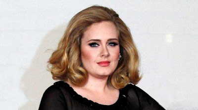 Adele pregnant her first child