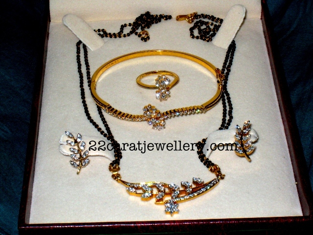 I love So Much this Black Beads mangal sutra Necklace Set Jewellery Designs