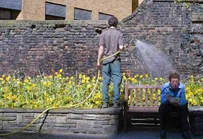 Coincidence photo man being watered