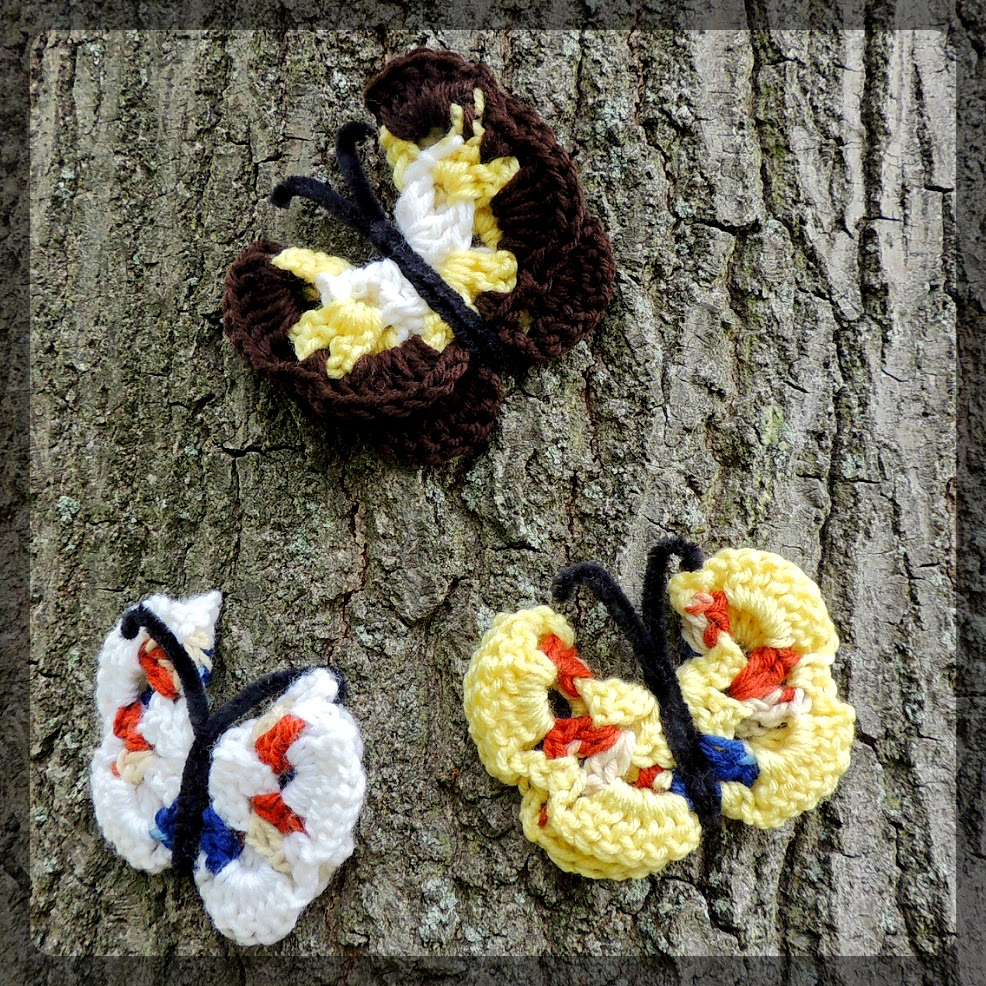 Crochet butterflies on a tree