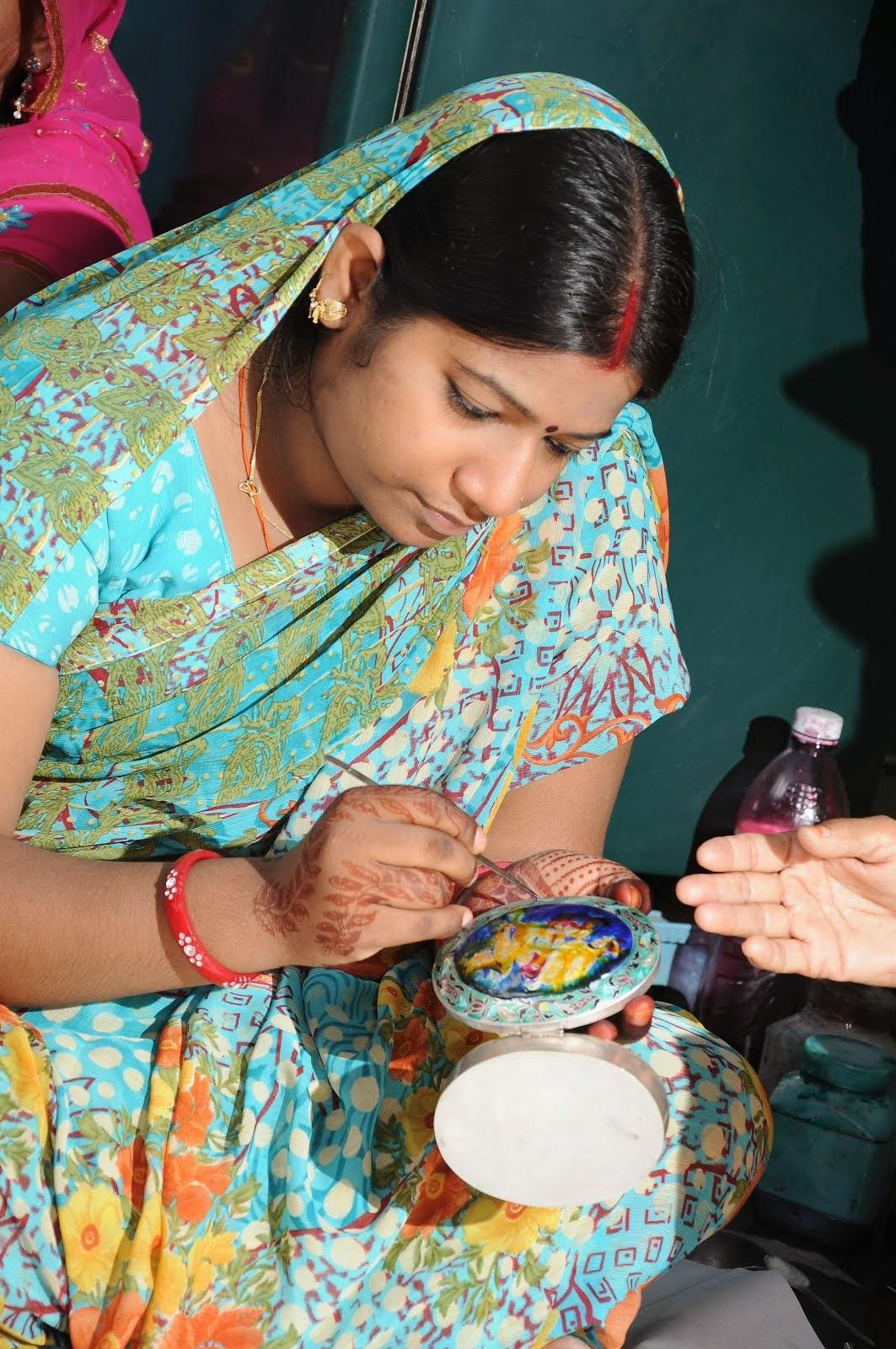 Rrual Woman doing meenakari work