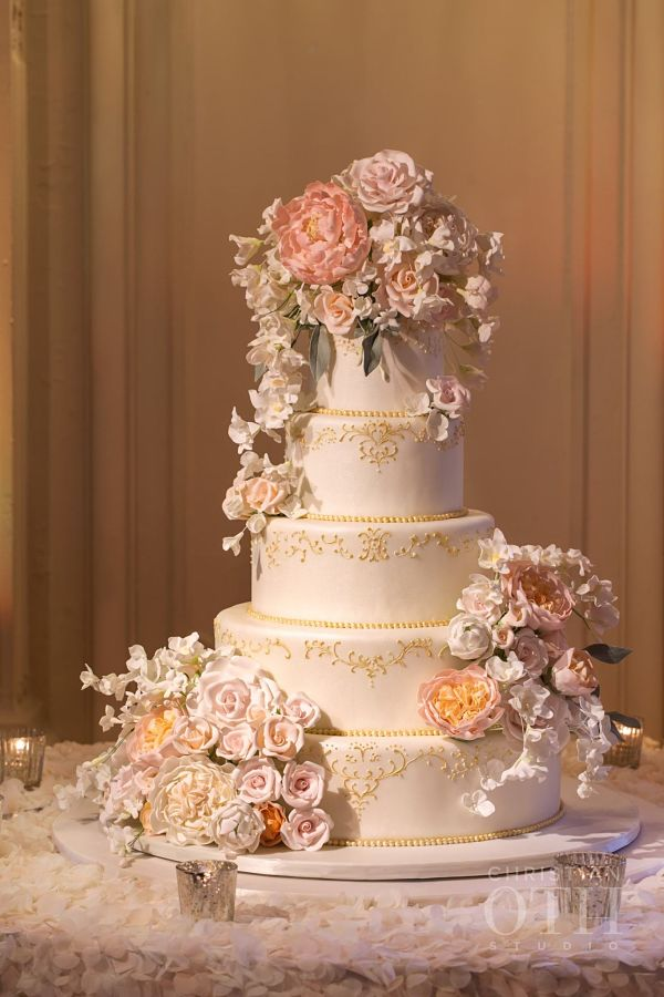 white and gold romantic custom wedding cake with sugar flowers