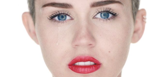 Miley Cyrus naked for wrecking ball video