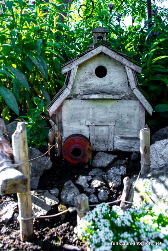 barn styled birdhouse in fairy garden