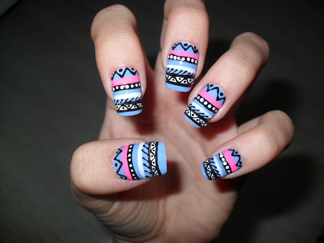 Made these nails using a striper brush dotting tool and a small