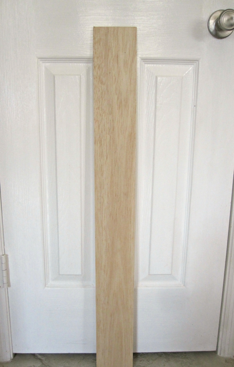 Balsa wood plank leaning on white door