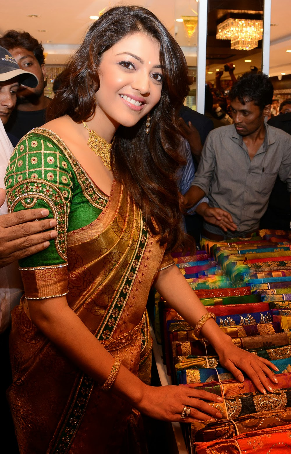 Kajal Agarwal in green blouse and golden saree, Kajal Agarwal side view in saree