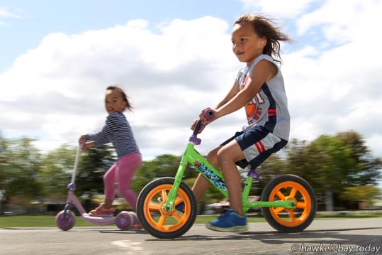 L-R: Alyzae-Rose Brown, 3, Haami Brown 4, Havelock North, playing at the skatebowl in the Havelock North Domain, Havelock North, in the warm weather. photograph
