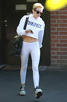 Miley Cyrus leaving recording studio in white outfit