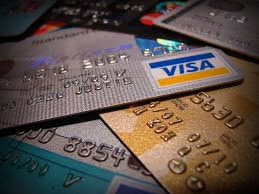 Image of multiple credit cards over a flat surface