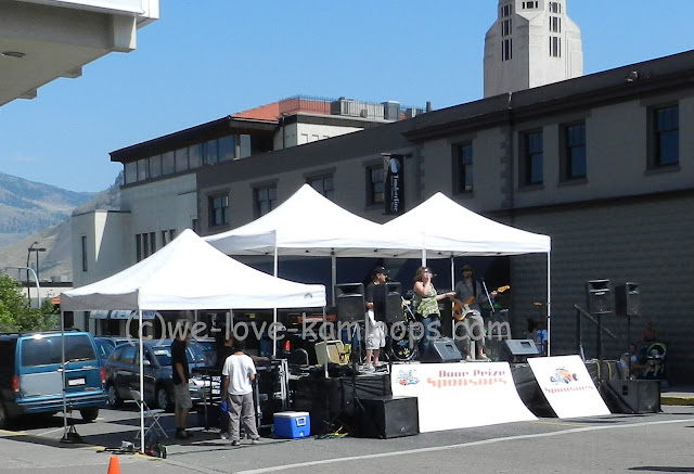 The band Blue Scarlett sing and the crowd enjoys their music during the car show