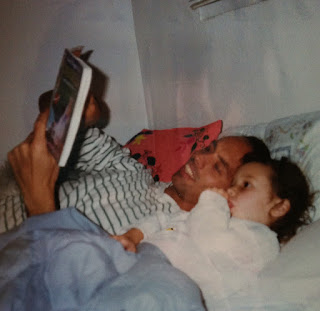 Reading, Dad and daughter spending quality time together.