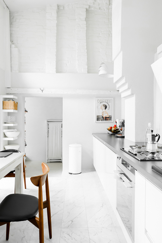 Contemporary eclectic loft kitchen. Photo by Carolina Bak