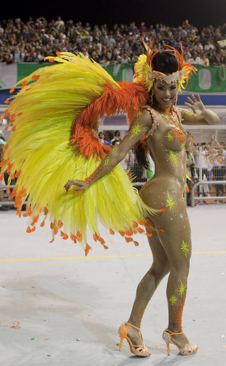 Samba heat: Scantily clad Brazilian babes flaunt their assets as they dance night away