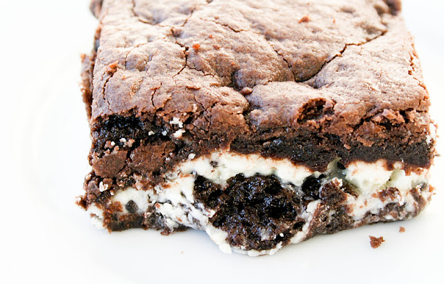 These cookies and cream brownies are so easy to make and it all starts with a chocolate cake mix and some Hershey's candy bars.