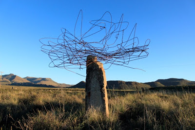 Land Art - wire on a rock outcropping in a landscape, by Strijdom van der Merwe
