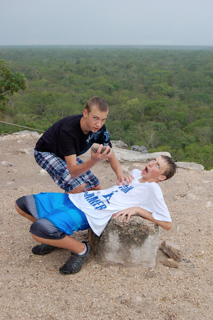 My Sons Performing a Fake Human Sacrifice on the top of the Pyramid Temple of Nohoch Mul in Coba Mexico