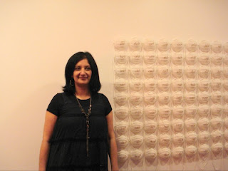Alia Toor, 99 Names of Aman, 2004, dust masks with cotton embroidery. Collection of the artist.