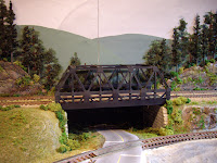 Upgraded warren-truss train bridge