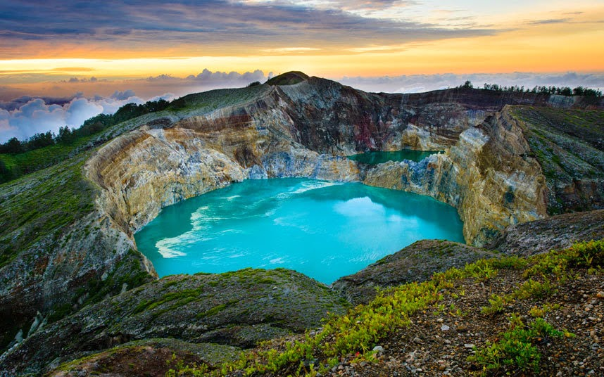 Kelimutu craters in Flores, Indonesia Local legend holds that at least one of these three lakes is inhabited by evil spirits and, when they can turn as dark as an inkwell, you can see why. Each crater lake changes colour and in the past they have been variously brown, red, turquoise and blue.
