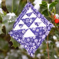 http://mychellem.blogspot.com/2013/12/dutchmans-puzzle-ornament-tutorial.html