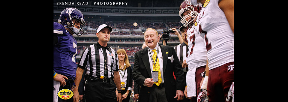 Sam Meineke tossing the coin prior to the Meineke Bowl Game in Reliant Stadium